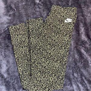 green and black designed small nike leggings